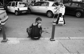 Young man sitting on the pavement, Bucharest 2011